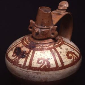 Vaso biconico con collo cefalomorfo  VII – X sec. d.C. (Lambayeque)